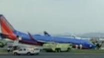 Raw: Plane's Nose Gear Collapses in NYC Landing