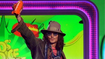 Depp and Stewart Avoid Slime at Kids Choice Show