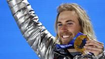 American wins gold medal on day 1 of Sochi games