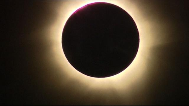 Australia: sky-gazers in awe of rare total eclipse