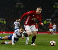 Man Utd's Rooney could miss League Cup final with muscle injury