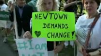 Hundreds in Connecticut protest Chris Christie over gun measure veto