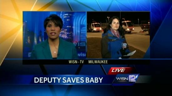 Deputy saves baby's life on hood of his squad car