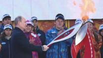 Raw: Putin, Security Guard Light Olympic Torch