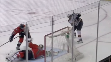 Ducks goaltender stretches across with his stick on tremendous save