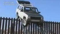 Suspects drive jeep over border fence, get stuck
