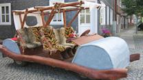 Motorist's Flintstones car banned by Germany, Homeless man cons his way into hotel stays for 2 years, and talking urinals target drunk drivers
