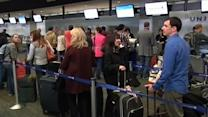 Americans pack airports, roads on busy travel day