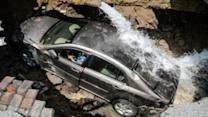 Instant Index: Sinkhole Swallows Car Driver Trapped Inside