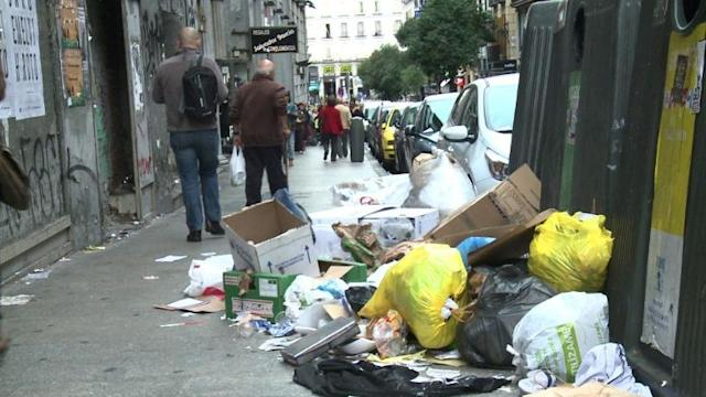 Garbage clogs streets of Madrid as sweepers strike