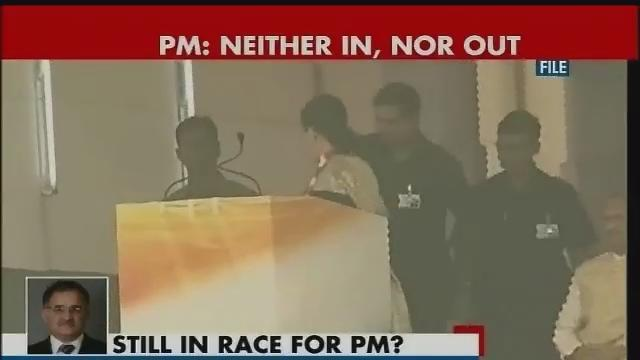 Neithr in, nor out of prime ministerial race, says Mnamohan Singh