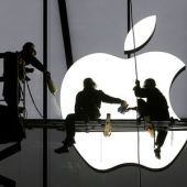 Apple sells more iPhones than expected, shares jump after hours