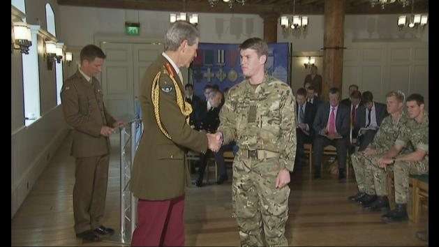 More than 100 members of armed forces receive honours