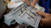 Dollar eases from highs on uncertainty over Fed, U.S. election