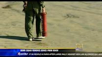 Bomb squad removes device from beach
