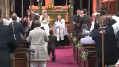 Bride and groom celebrate wedding with a flash mob dance