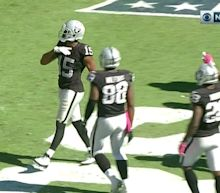 Michael Crabtree touched his shoulder and was flagged for unsportsmanlike conduct