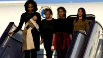 First lady Michelle Obama and daughters arrive in Beijing