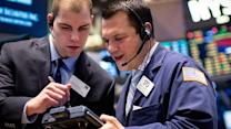 World markets wobble after Fed statement,  falling oil