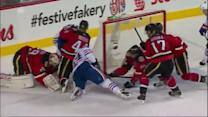 Reto Berra sticks out the pad in time