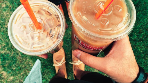 Dunkin' Donuts is taking on Starbucks to win over a growing $2 billion industry