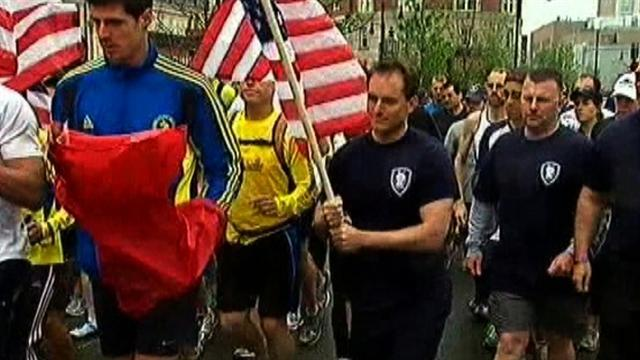 Boston runners symbolically finish race cut short by bombing