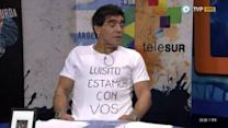 Maradona supports Luis Suarez. Suarez misses hero's welcome