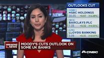 Moody's cuts outlook on some UK banks