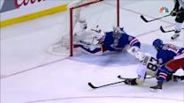 Crosby scores on Lundqvist while falling to the ice