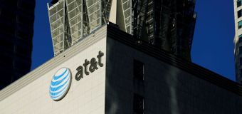 US sues to stop AT&T buying Time Warner