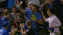 Really large man catches foul ball at Rockies-Cubs game