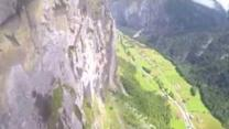 Wingsuit Flight Through a Swiss Waterfall